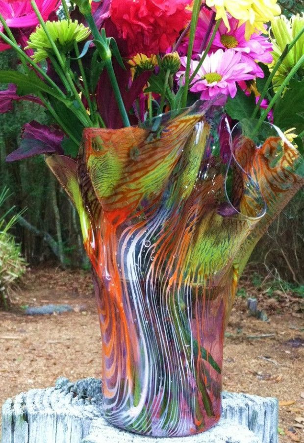 Custom made multi-colored vases made entirely from recycled water bottles // Upcycle This! 27 Creative Ways People Recycle Plastic Bottles