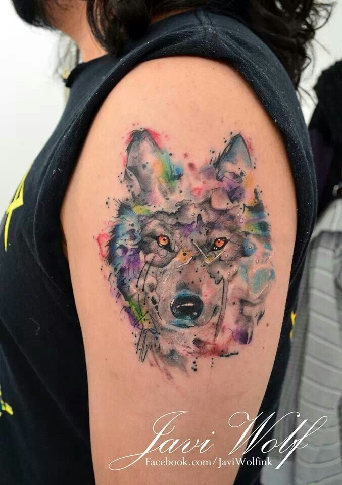 Wonderful wolf watercolor tattoo on arm for woman