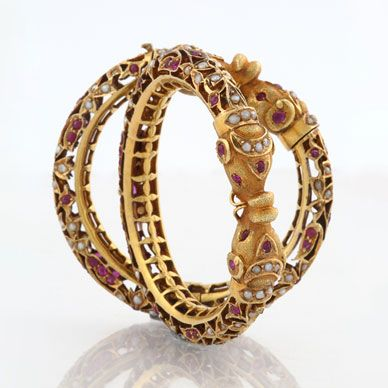 A PAIR OF RUBY AND PEARL 'KADA' BANGLES-