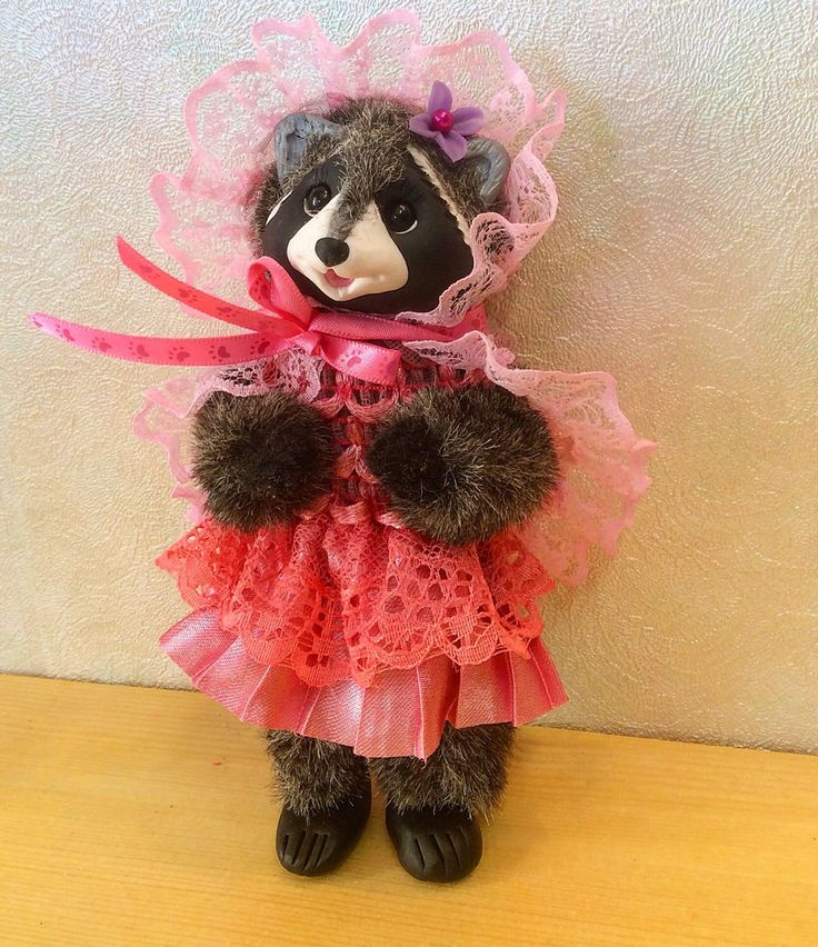 A personal favorite from my Etsy shop https://www.etsy.com/listing/497117846/raccoon-lady-handmade-toy-miniature-doll