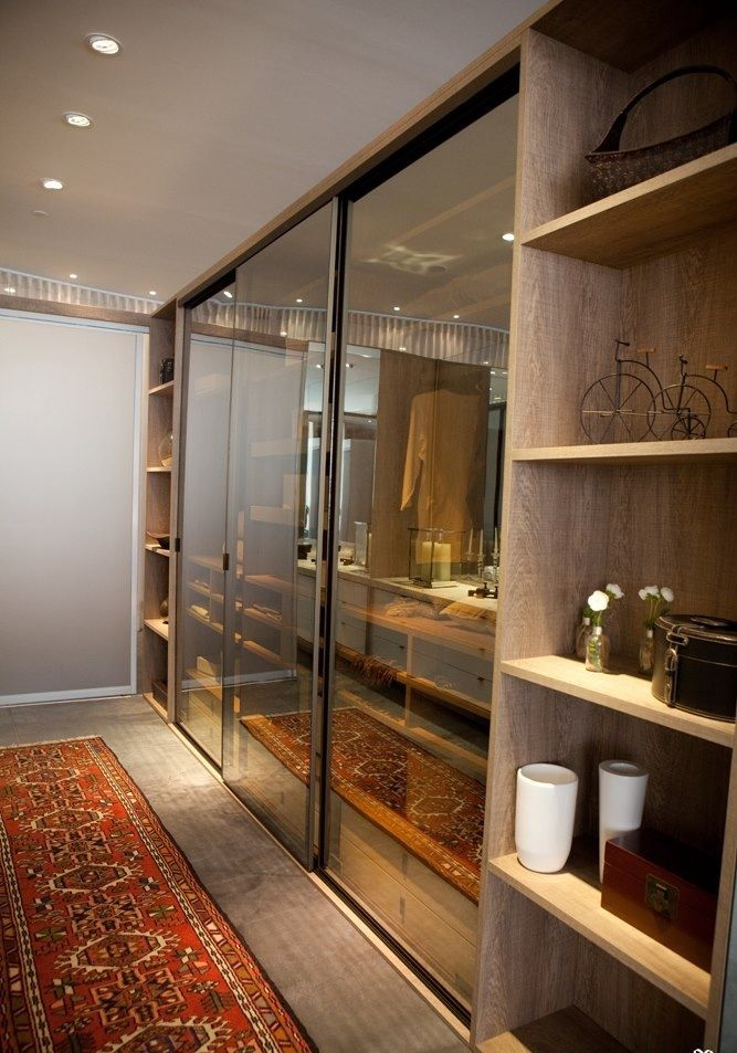 Instead of having mirror doors have glass separations with curtains behind