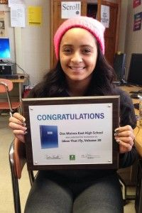 """East senior Jailene Rodriguez has earned national recognition for a photograph featured in the East High School yearbook, """"The Quill."""" Her photograph from a Scarlets football game earned a spot in Herff Jones' 2014 volume of """"Ideas That Fly,"""" a publication that recognizes the top yearbook covers, designs, coverage, and photography from across the country. Congratulations to Jailene, faculty adviser Natalie Niemeyer and the entire staff of The Quill for their great work at East High."""