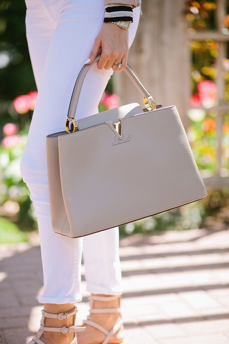 Neutral gray handbag from Louis Vuitton. Awesome handbag inspiration, pin now!