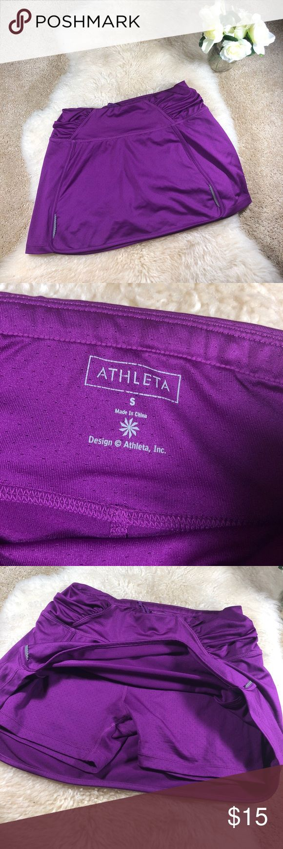Athleta skirt with built in shorts Athleta skirt with built in shorts. Good condition. Size small. Length about 12.5 inches. Pretty purple color. Pocket in back. Bundle and save! :) Athleta Skirts Mini