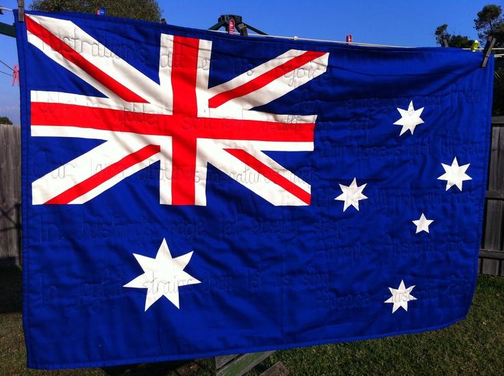 Australia flag panel. The machine quilting is the lyrics of advance Australia fair.