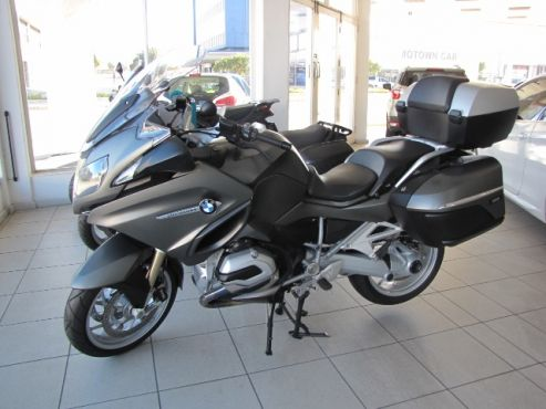 2014 BMW R1200 RT LC  •4 522 kms  •R 174 900  •VPS- (Vehicle Protection Shield) on Tank, Foot Pegs and Pillions •BMW BAGS (x3)  inside Top Box and side Panniers •Aluminium Pod Protectors •Dynamic ESA  •Daytime running Light  •92kW  •Hill Start Control  •Headlight Pro  •Shift Assistance Pro  •Driving Mode Pro  •Touring Packet  •Dynamic Packet  •Navigation System – Motorad •Touch Screen Display for Navigation •Seat Heating  •RDC  •Cruise Control  •Top Box  •2 x Side…