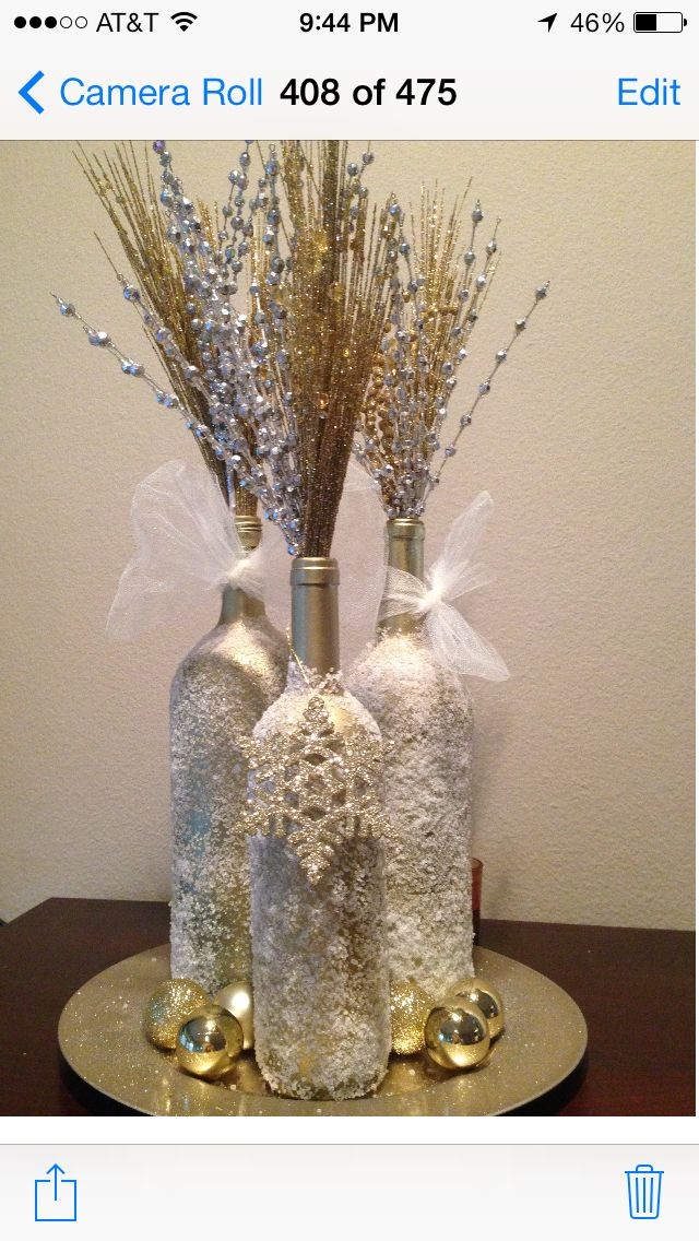 Paint wine bottles, spay with adhesive, and roll them in Epsom salt! Then fill with decor!