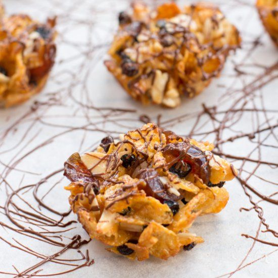 A Florentine biscuit or Florentines are made of nuts, glacier cherries, dried fruit and they have chocolate coated bottom.
