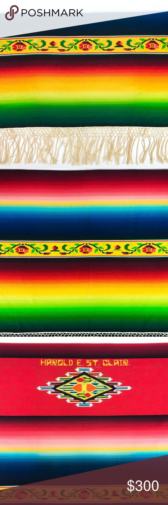 """1940s/50s Mexican serape Saltillo blanket Gorgeous Mexican serape Saltillo blanket. Rainbow stripes with strips of floral design and knotted fringe trim. Lovely diamond design in the center with """"Harold E. St. Clair"""" printed above. Estimated to be from the 1940-50's. Feels like wool. This southwestern throw has so much diversity and can be used as a wall tapestry, blanket, or rug. Excellent condition for it's age, only one small spot where the thread is thinning, right below the name…"""