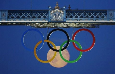 Photography by Luke MacGregor   Full moon rises through the Olympic Rings hanging beneath Tower Bridge during the London 2012 Olympic Games on 3 August: Olympics Games, Summer Games, Olympics Rings, The Bridges, Full Moon, Photo Galleries, Blue Moon, Towers Bridges, The Moon