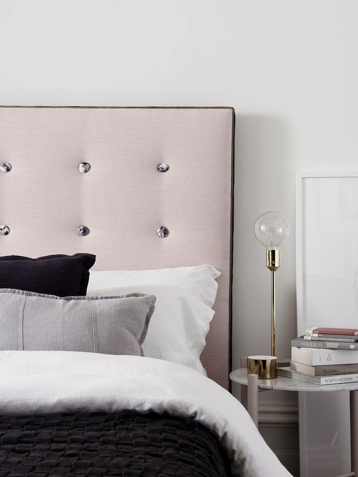 Classic Contemporary - Blush luxe Belgian linen bedhead with feature marbled resin buttons sitting behind luscious layers of grey and fresh white.