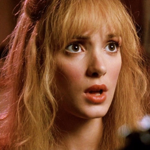 Winona Ryder can be blonde. I don't think I can. Not without some kind of red or something...though that looks a little red there. I don't like the orange lipstick, though. Clashes with the saccharine-sweet pink cheek blush...which I don't like either.