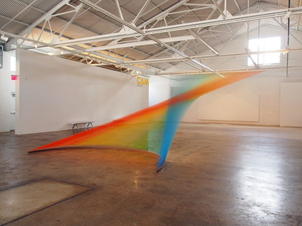 """""""Dawe combines optical art, form and tactility to glorious effect using thousands of multicoloured threads, strung over hundreds of hours, he creates beautifully prismatic installations that shift perceptually depending on one's view point in the room."""""""