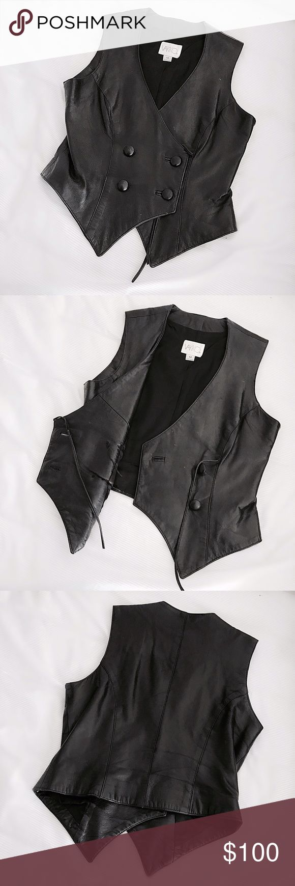 "Vintage Vakko Leather Tuxedo Vest Butter soft black leather vest by Vakko leather with a double breasted, exaggerated silhouette. Button and optional tie closure, super cool over an oversized button down with loose fit jeans and loafers. Approx 24""L and 18""pit to put. Marked size M, fits true to size but can be worn on a size S as well if you like a slightly boxy fit. Excellent vintage condition with some very slight marks and buttons are a little loose (can be re-sewn if you think it's…"