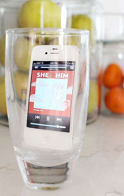 Put your phone in a glass to make the music loud enough to fill the room. Whoa! Genius!