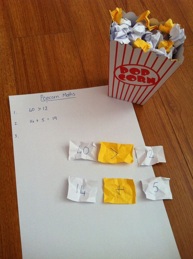 Popcorn math game: fill the popcorn box with crumpled up pieces of yellow and white paper. On the white paper (plain popcorn) write numbers, on the yellow (buttered popcorn) write math symbols (+ – x ) (Division symbol not included, as it would make the activity too complicated).  Have child pick 2 plain and 1 buttered piece per round, arrange the pieces in the proper order and solve for the answer.