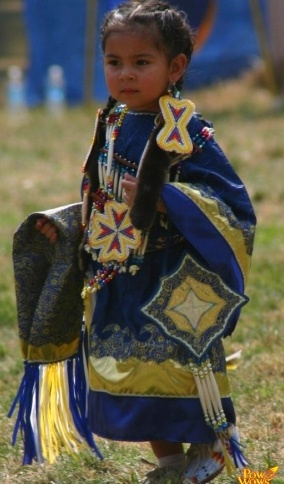 This photo shows a young Native American Dancer. Typically, dances are taught at…