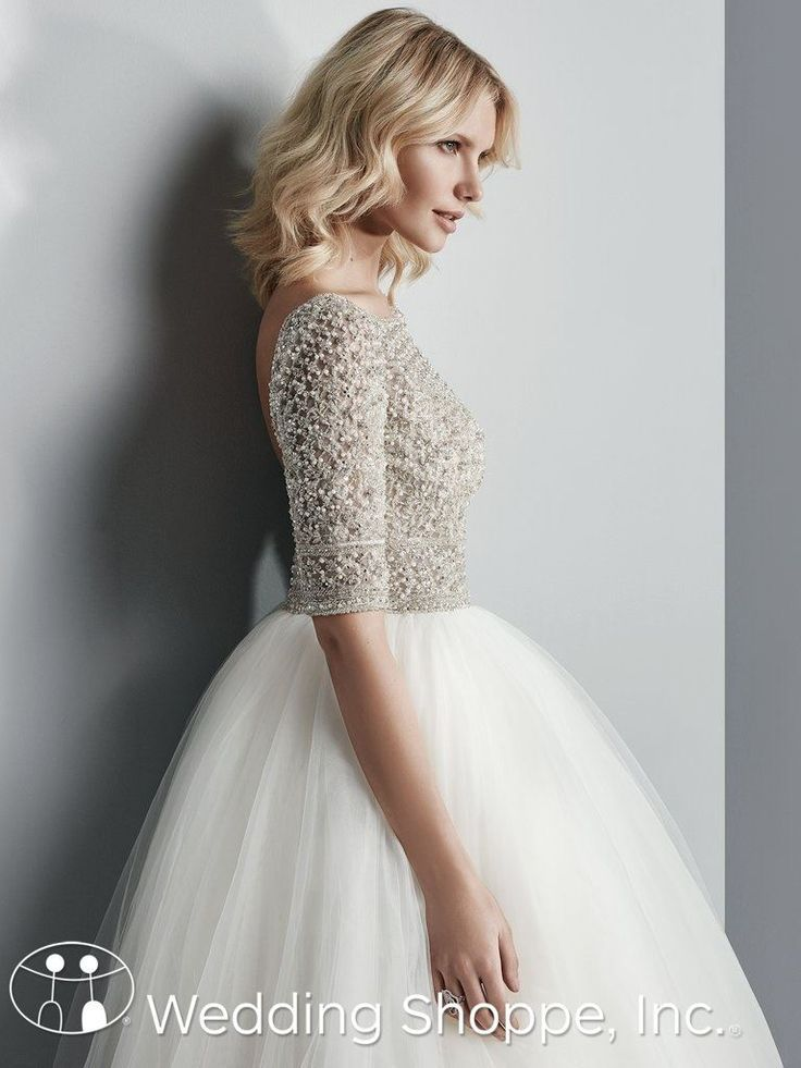 With beaded tulle, Swarovski crystals, and half sleeves, this ball gown bridal dress is perfect   Sottero and Midgley Allen Ball Gown Wedding Dress   The Wedding Shoppe