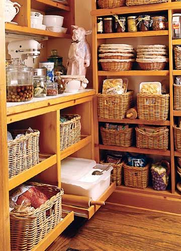 pantry that is swoon worthy. I'm going to start collecting baskets to re-do my own pantry! What a way to save space