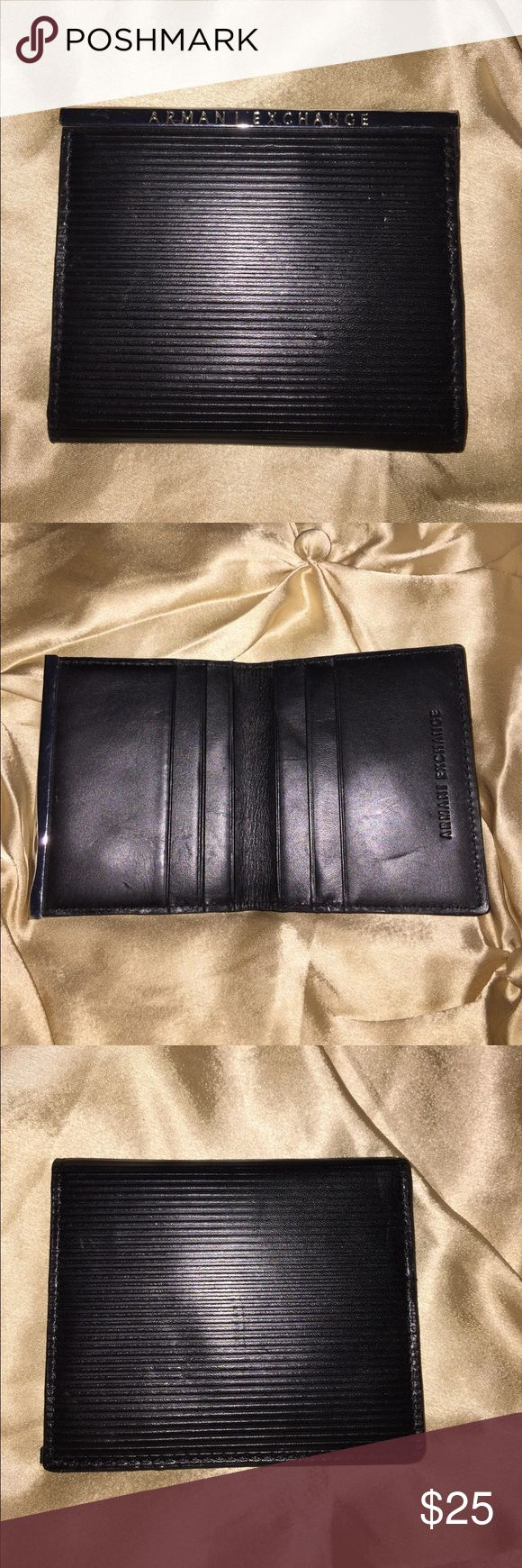 Men's Armani Wallet Good used condition. It has 6 credit card slots. Please use offer button to make an offer. Thank you for looking! Armani Exchange Bags Wallets