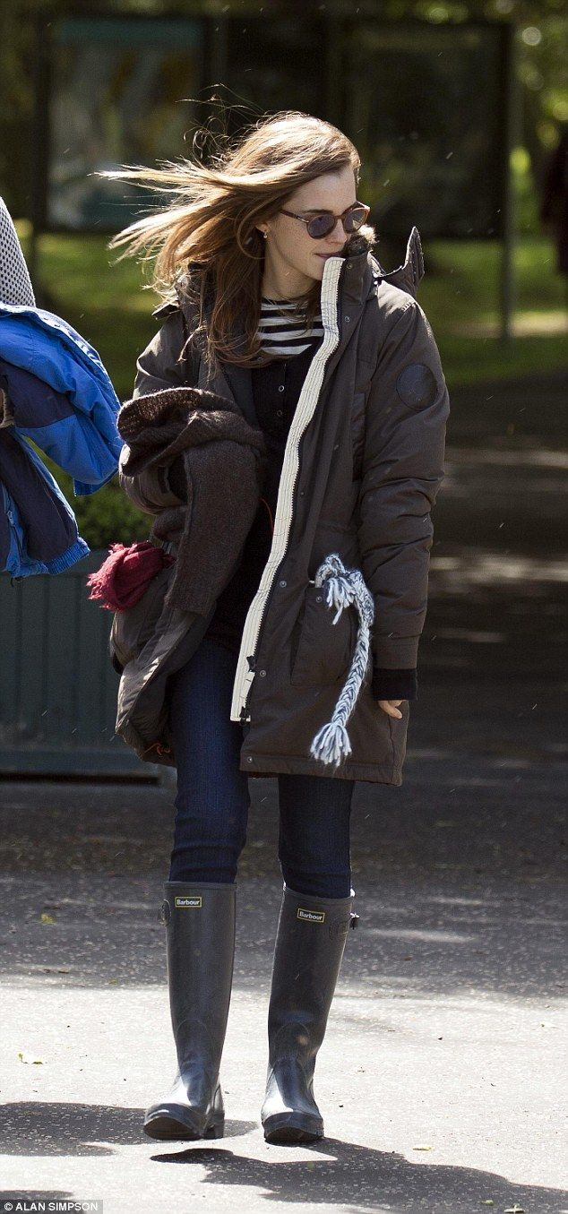 Feeling chilly? The Harry Potter star kept cosy in her wet weather wear as she left the Sc...