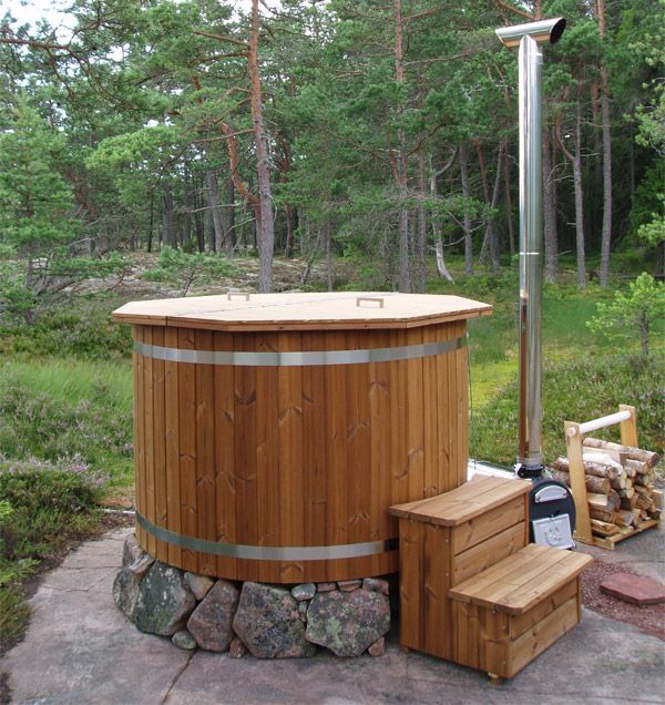 Picture shows our Basic hot tub with a wood fired heater, stairs and lid