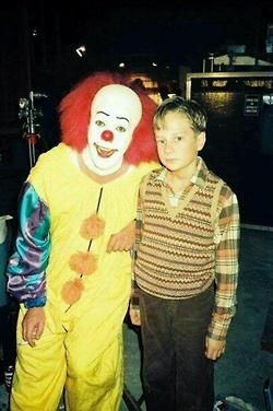 """On the set of """"Stephen King's It"""". He doesn't look entirely comfortable with Tim Curry even tho they're not filming. Had to have been creepy. He was THAT good!"""