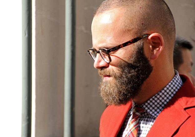 LOVE: the GLASSES, checked SHIRT, plaid TIE, & colorful BLAZER . . .  But HATE: the beard (especially w/ an almost shaved head which has a lopsided look); is he handsome under all that fuzz (no/yes)? How long does he pick out food after eating - does he have to shampoo it or just use a napkin & brush? Do I get a mouthful of fuzzy-wuzzy if he kissed me? EWWWWW !!! (ParisFashionWeek)
