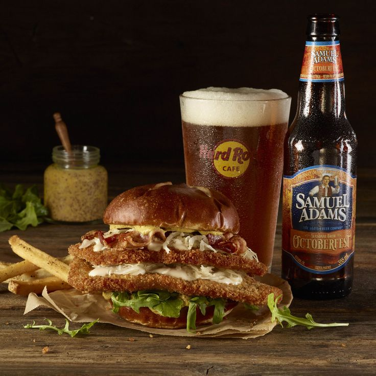 The rock-and-roll-themed restaurant chain is celebrating Oktoberfest in a big way this year, with a limited-edition Samuel Adams' Octoberfest Schnitzel Burger. Breaded pork schnitzel is topped with smoked bacon, sauerkraut, mustard, arugula and beer-infused cheese sauce, which is all served on a pretzel bun. You can start finding it in cafes by mid-September.   - Delish.com