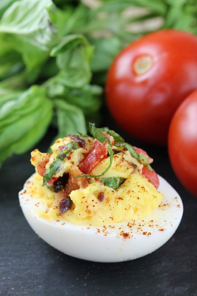 Bacon, Basil (in place of lettuce), and Tomato form this BLT Deviled Egg. This appetizer may be simple, but it packs a punch.