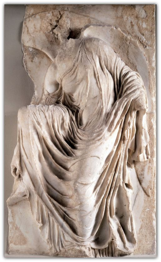 """Nike adjusting her sandal, from the south side of the parapet of the Temple of Athena Nike, Acropolis, Athens, Greece, ca. 410 B.C. Marble, approx. 3' 6"""" high. 