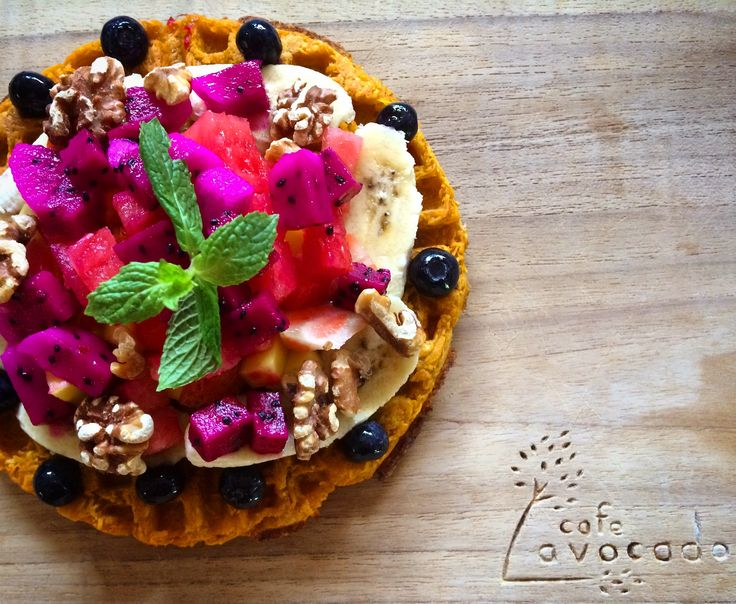 Paleo Sweet potato waflle with fresh fruits and peppermint leaf by Avocado Cafe Bali