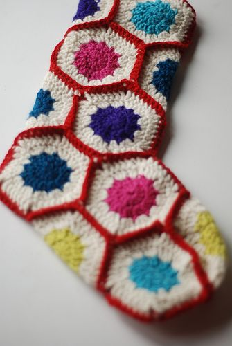 Crochet Christmas Stocking  Add some retro flair to your mantel with these punchy granny stockings. Hexagon motifs are easy to stitch in any color combo for a fun, festive look!