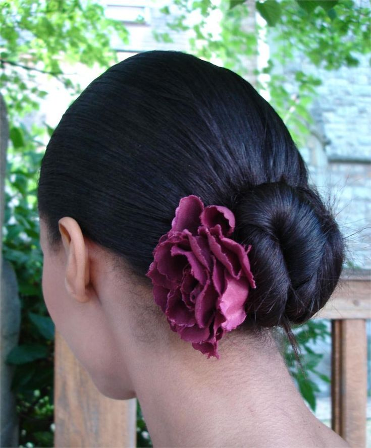 This a perfect bridesmaid hairstyle and it's so low maintenance! Secure the hair in a bun at the nape of the neck and accessorise with a flower to match your wedding flowers.