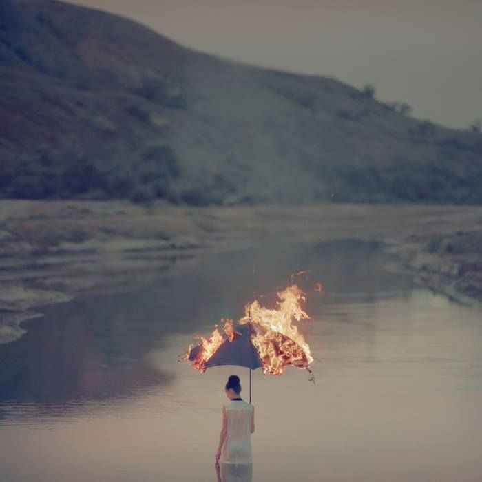 What to do when the one thing that saves you from the rain, is on fire? Photographer Oleg Oprisco