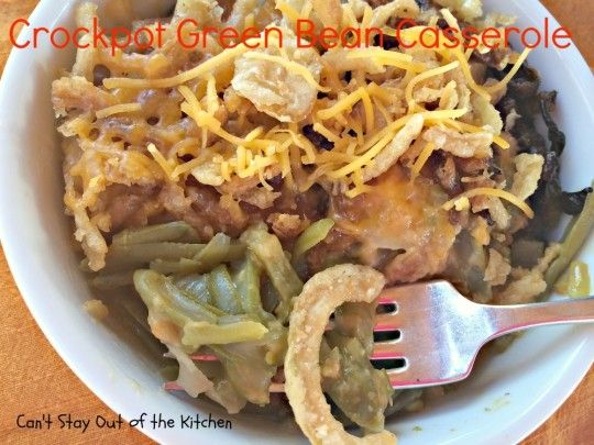 Crockpot Green Bean Casserole - fabulous Green Bean #casserole with water chestnuts, cheese, cream of celery soup and French fried onions. #greenbeans #sidedish #veggie via Can't Stay Out of the Kitchen