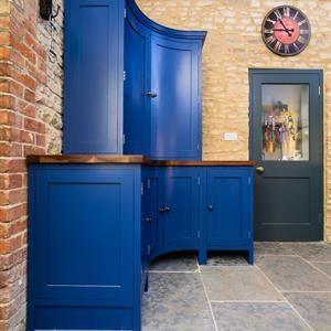 Evie Willow bespoke painted shaker kitchen. Stiff key blue. Curved dresser. American black walnut surfaces.
