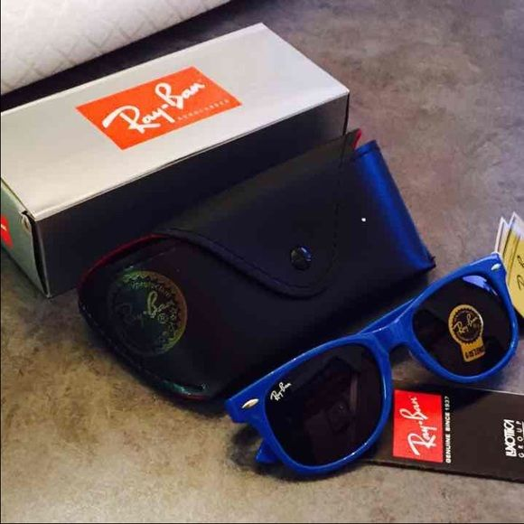 NWT Ray Ban Wayfarer Blue Sunglasses NWT Ray Ban Wayfarer Sunglasses • Blue • Comes with Case and Manual • 100 % Authentic • I no longer have the box FREE SHIPPING on orders of $50 or more including bundles Ray-Ban Accessories Glasses