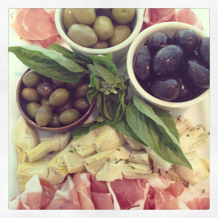 ZARA'S Antipasti Prosciutto di Parma, marinated artichoke hears, green & black Cerignola olives and french Picholine olives. www.zarasdeli.com
