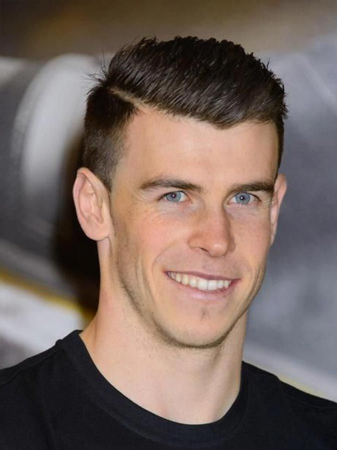 Soccer players are mysterious––they move like cheetahs on the field, but somehow they still have awesome hair. Here's how to get some of the dapper soccer haircuts that players are sporting. Cristiano Ronaldo Haircut This Ronaldo-inspired haircut is a windswept undercut with a hard part. The hair on top looks like it's eternally caught in