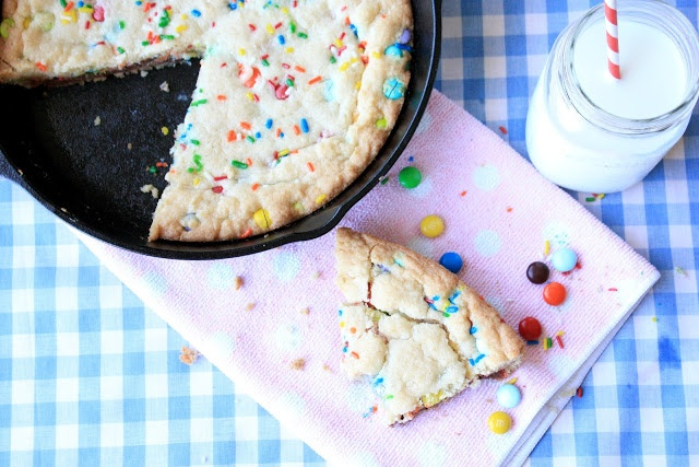 Skillet Sugar Cookie - Crispy around the edges, chewy sugar cookie goodness in the middle, studded with m candies...doesn't get much better than that.