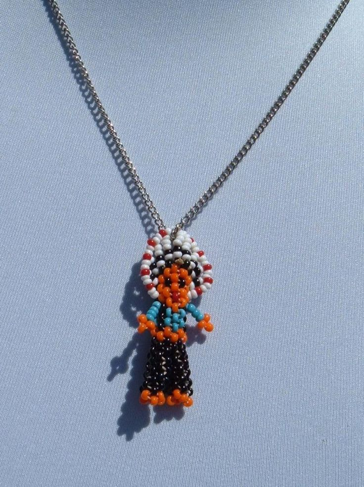 Beaded doll pendants.