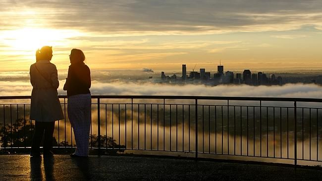 A foggy morning sunrise over Brisbane City from Mt Coot-tha lookout.