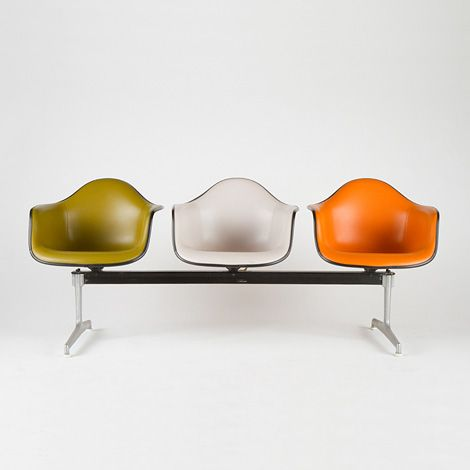 Charles and Ray Eames; Polished and Enameled Aluminum Base with Tandem #3733 Plastic and Naugahyde Shells, 1972. I have a triple beam and multiple shells and have done this to great effect, like this.