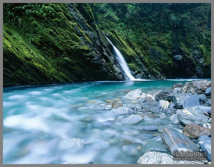 Small side creek entering the beautiful blue Burke River, Haast Pass, South Westland.