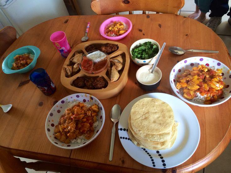 Indian feast night. Homemade tikka masala, samosas, bhajis, poppadoms, dips & yoghurt.