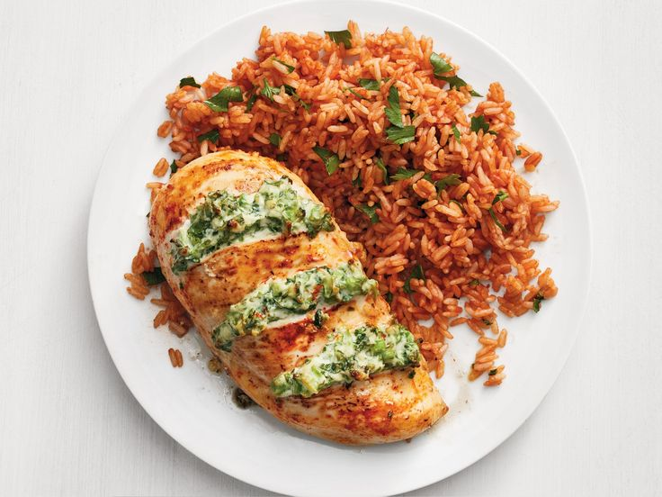 Get this all-star, easy-to-follow Cheesy Broccoli-Stuffed Chicken with Tomato Rice recipe from Food Network Kitchen