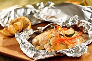 Tender fish fillets are topped with mayonnaise, Parmesan and crisp vegetables, then wrapped in foil packets for easy grilling.