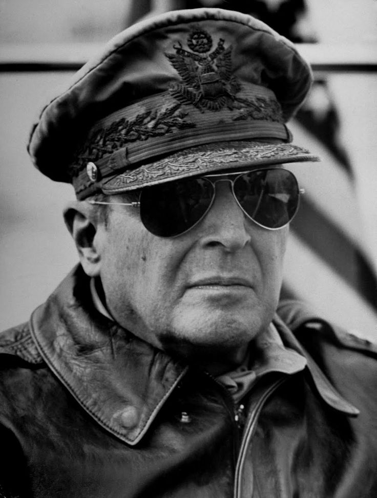 Gen. Douglas MacArthur, on the bridge of flagship U.S.S. Mount McKinley,  watching his X Corps (two regiments of the 1st Marine Division) making  assault lan...
