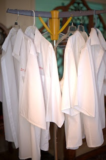 science party- lab coats from men's white shirts  To make the lab coats, you cut the sleeves just above the arm button area so they are plain sleeves. Then cut the bottom of the shirt so its straight across. Hem the bottom and the sleeves. I saved the sleeve material to use to make extra pockets on the coats,